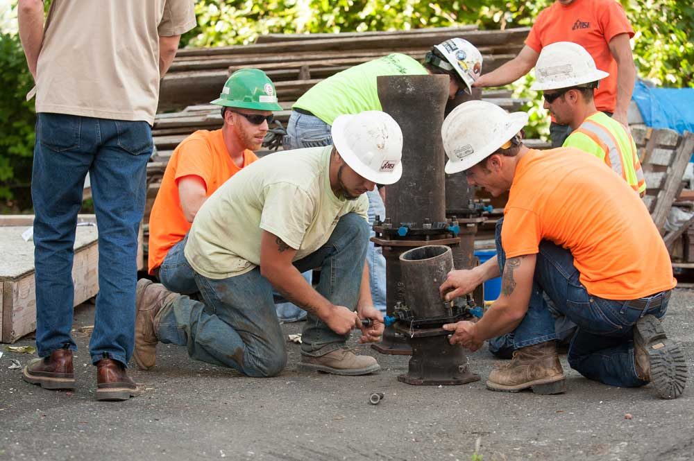 apprentices learning how to operate new tools and techniques
