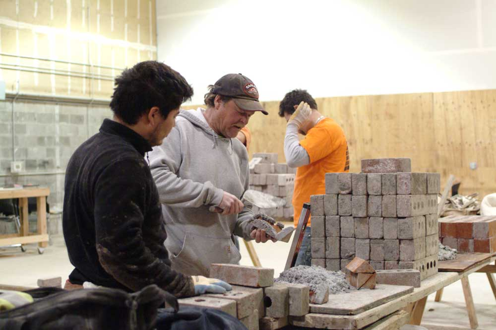 Instructor showing student how to build