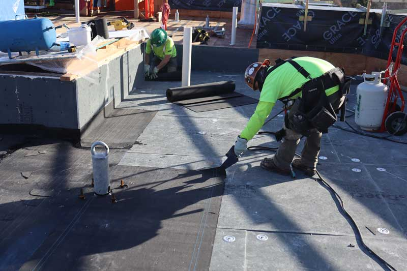 hard at work at the roofers apprenticeship