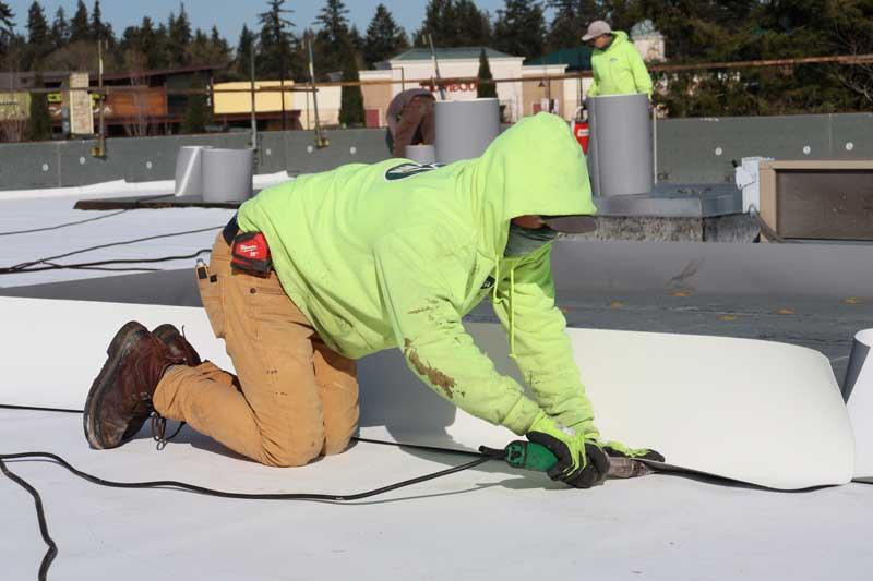 roofer apprentice hard at work